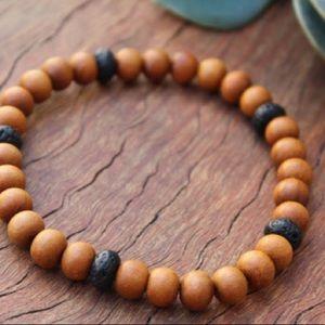 Sandalwood & Lava aromatherapy diffuser bracelet.